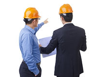 Asian businessmen. With safety helmet and blueprint, rear view Royalty Free Stock Images
