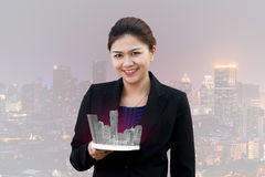 Asian businesspeople with cityscape royalty free stock images