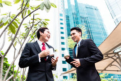 Asian businesspeople drinking coffee outside Stock Photography