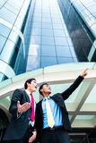 Asian businesspeople in front of high rise building Stock Images