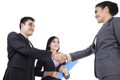 Asian businesspeople handshaking Stock Images