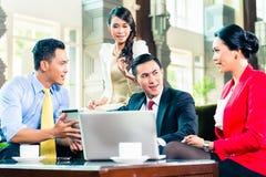 Asian businesspeople having meeting Stock Photo