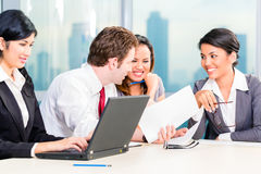 Asian Businesspeople having meeting in office Royalty Free Stock Photos