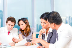 Asian Businesspeople having meeting in office Stock Image