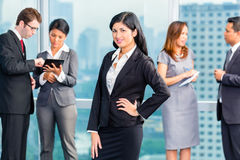 Asian Businesspeople having meeting in office Stock Photo