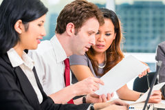 Asian Businesspeople having meeting in office stock images