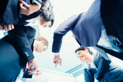 Asian Businesspeople looking at flipchart Royalty Free Stock Images