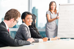 Asian Businesspeople making notes Stock Photo