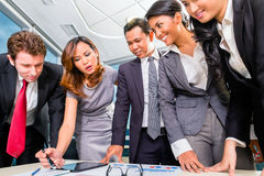 Asian Businesspeople meeting in office Royalty Free Stock Images
