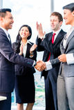 Asian Businesspeople shaking hands Stock Image