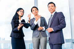 Asian Businesspeople standing in office Royalty Free Stock Photo
