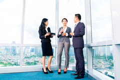 Asian Businesspeople standing in office Stock Photo