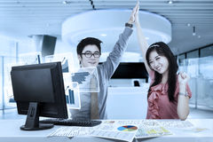 Asian businesspeople with virtual graph Stock Photography