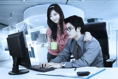 Asian businesspeople work with virtual chart Royalty Free Stock Photography