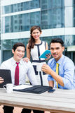 Asian businesspeople working outside with coffee Royalty Free Stock Photo
