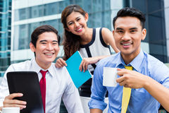 Asian businesspeople working outside with coffee Stock Photography