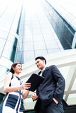 Asian businesspeople working outside on pad Stock Images