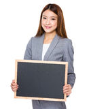 Asian businessswoman show with black board Royalty Free Stock Photos