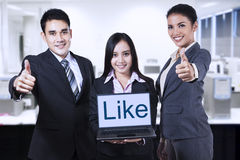 Asian businessteam showing like on laptop Royalty Free Stock Photos