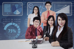Asian businessteam smiling on camera Stock Photo