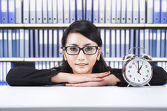 Asian businesswoman with alarm clock Royalty Free Stock Photos