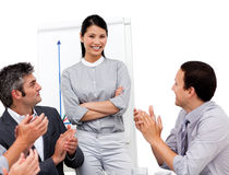 Asian businesswoman applauded for her presentation Stock Photography