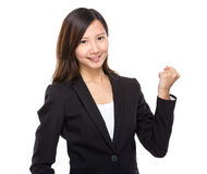 Asian businesswoman arm clench. Isolated on white background royalty free stock image