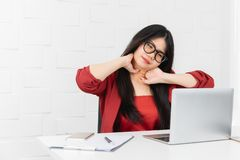 Asian businesswoman being relaxed from sitting in the office royalty free stock photo