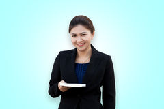Asian businesswoman with book in hand Stock Photos