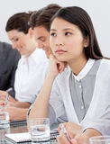Asian businesswoman bored at a presentation Royalty Free Stock Photo