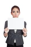 Asian businesswoman boring hold a blank sign Royalty Free Stock Photography