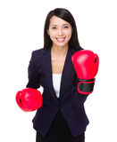 Asian businesswoman with boxing gloves for cheerup gesture Stock Photos
