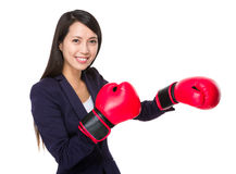 Asian businesswoman with boxing gloves Stock Photography