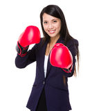 Asian businesswoman with boxing gloves ready for fighting Stock Photography