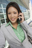 Asian Businesswoman On Call Stock Photo