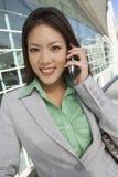 Asian Businesswoman On Call Stock Photo