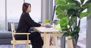 Asian businesswoman is calling smartphone. stock footage