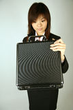 Asian businesswoman with case Stock Images