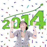 Asian businesswoman celebrating a new year 2014 Royalty Free Stock Photo