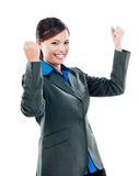 Asian Businesswoman Celebrating Success. Portrait of a successful Asian businesswoman cheering with clenched fists against white background Stock Photography