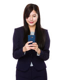 Asian businesswoman check email on cellphone Royalty Free Stock Image
