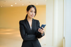 Asian Businesswoman check text message on cellphone Stock Photo