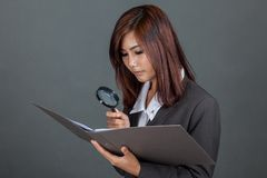 Asian businesswoman checking data in folder Stock Photography