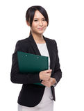 Asian businesswoman with clipboard Royalty Free Stock Photography