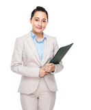 Asian businesswoman with clipboard Stock Photo