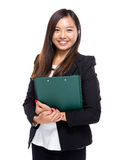 Asian businesswoman with clipboard Stock Image