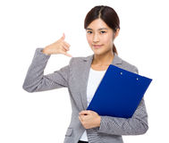 Asian businesswoman with clipboard and ok sign Stock Images