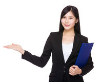 Asian businesswoman with clipboard and open hand palm Stock Photography