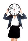 Asian businesswoman with clock on face Royalty Free Stock Photos