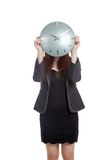 Asian Businesswoman close her face with a clock Royalty Free Stock Photos